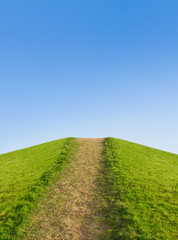 Pathway up the hill against the sky. Symbol development or caree