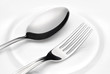 Flatware. Spoon and fork on a plate