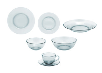 Tableware. Glass plates, bowls and cups on a white background.