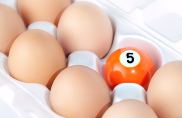 Eggs and billiards ball