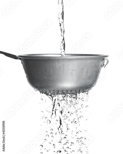 Water poured through a strainer