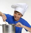 Niño chef sujetando una olla,cocinando.