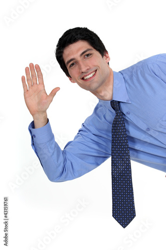 A businessman waving.