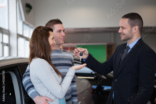 Businessman holding car keys