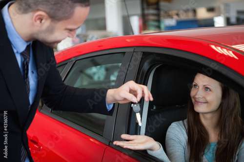Customer receiving car keys
