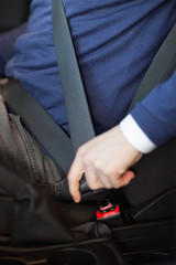Man fastening his seatbelt