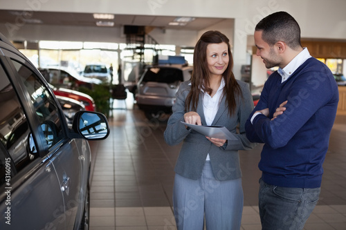 Woman explaining something to a man