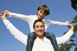 little boy on his father's shoulders
