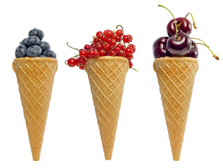 ice cream waffle cone with berries fruits concept isolated