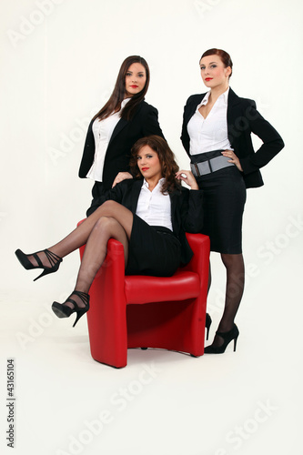 Three women in suggestive poses