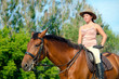 Beautiful girl on the farm with her horse.