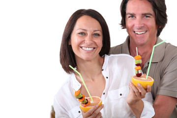Couple drinking real fruit juice