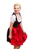junge blonde Frau im rot-schwarzem Dirndl