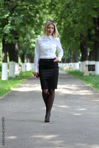 young business woman walking on the street