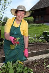 Older woman in her garden