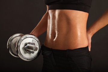 Female lifting a dumbbell