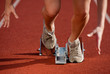 close-up image of a female sprinter leaving the starting blocks