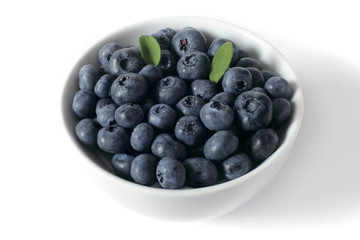 blueberries with leaves in a cup