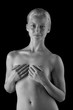 Black and white art photo of a beautiful nude woman's body
