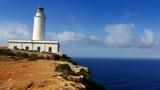 Formentera La Mola lighthouse in the blue Mediterranean sea poster