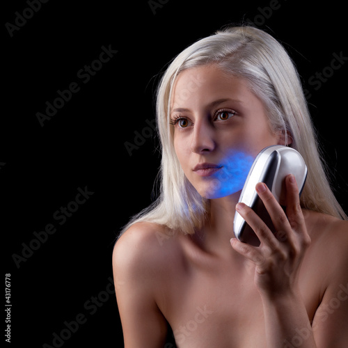 Young woman getting phototherapy treatment