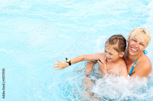 woman and  little girl swimming