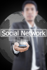 Businessman Holding mobile with Social Network word.