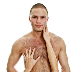 Woman's hands touching man's chest. Isolated on white.