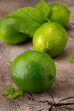 Fresh limes on wooden table