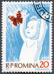 ROMANIA - 1962: shows Child and Butterfly