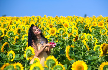 Pregnant woman in sunflowers