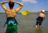 The instructor of kite-surfing and his student