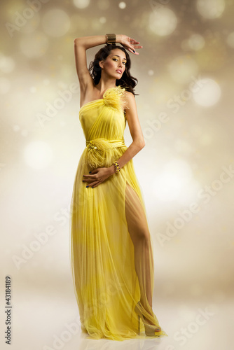 beautiful woman in yellow evening dress