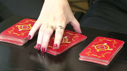 Fortuneteller diplaying cards