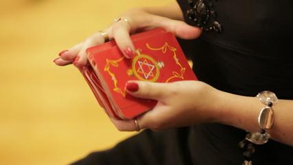 Woman shuffling a deck of taro cards
