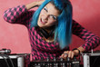 Punk girl DJ with dyed turqouise hair