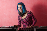 Punk girl DJ with dyed turqouise hair poster