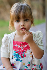 Cute toddler portrait in outdoor park