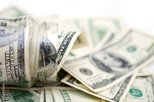 dollars in money jar