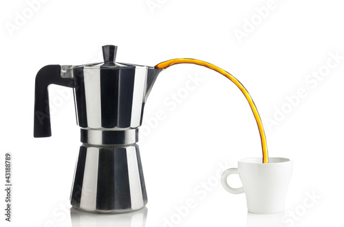 filling a cup of coffee with an Italian coffee maker