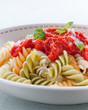 plate of fusilli with tomato sauce