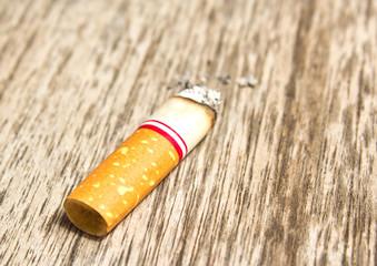 Cigarette on the wood floor