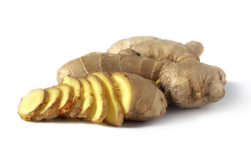 ginger with a few slices on white background
