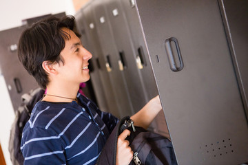 Student putting things in locker