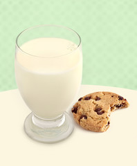 Milk and Cookie with Bite Taken on Green background