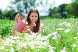 Young woman holding watering can