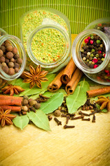 Pack of several spices and herbs in glass jars