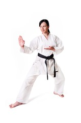 Karate woman posing on a white background
