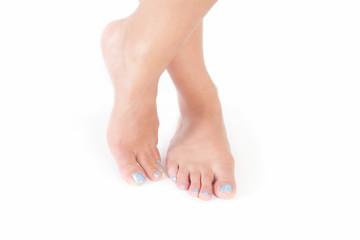 Pretty female feet with light blue nail polish