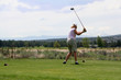 Lady golfer hitting ball from tee